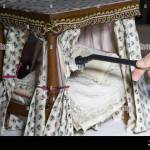 A Miniature Four Poster Bed Being Cleaned Of Dust During The Annual Stock Photo Alamy