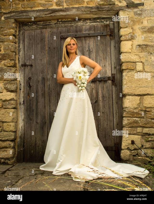 bride with long blonde hair in white wedding dress stock
