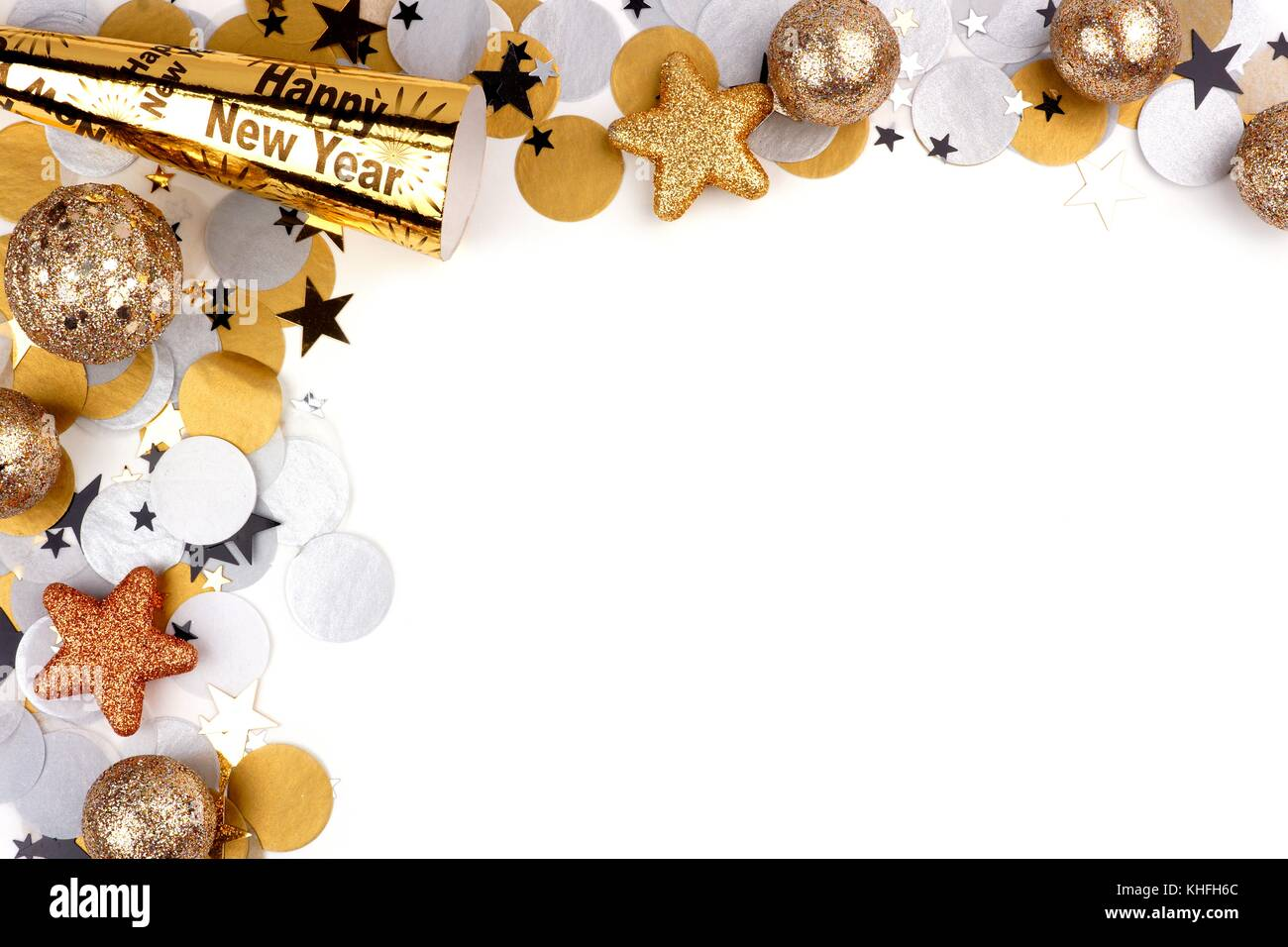 New Years Eve corner border of confetti and decor isolated on a     New Years Eve corner border of confetti and decor isolated on a white  background