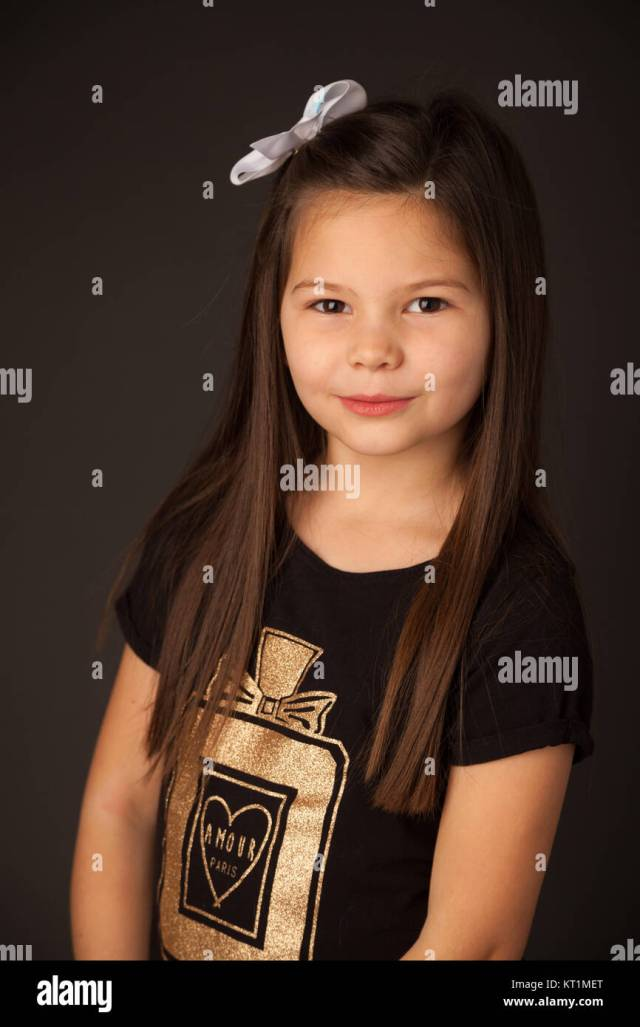 portrait of a 7 year old girl with dark hair in a studio
