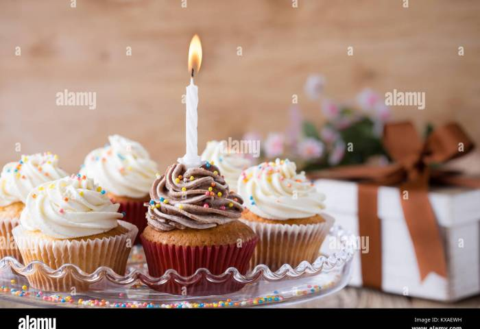 Delicious Birthday Cupcakes With One Candle Served On Glass