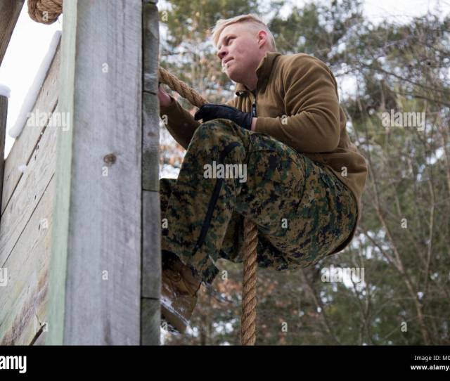 U S Marine Corps Lance Cpl Paul Terrafino A Field Radio Operator With Marine Wing Communications Squadron 28 Maneuvers Through An Obstacle At The