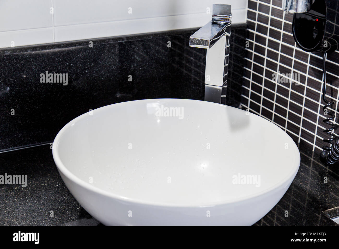 View of elegant bathroom with black tiles  very shallow depth of     View of elegant bathroom with black tiles  very shallow depth of field