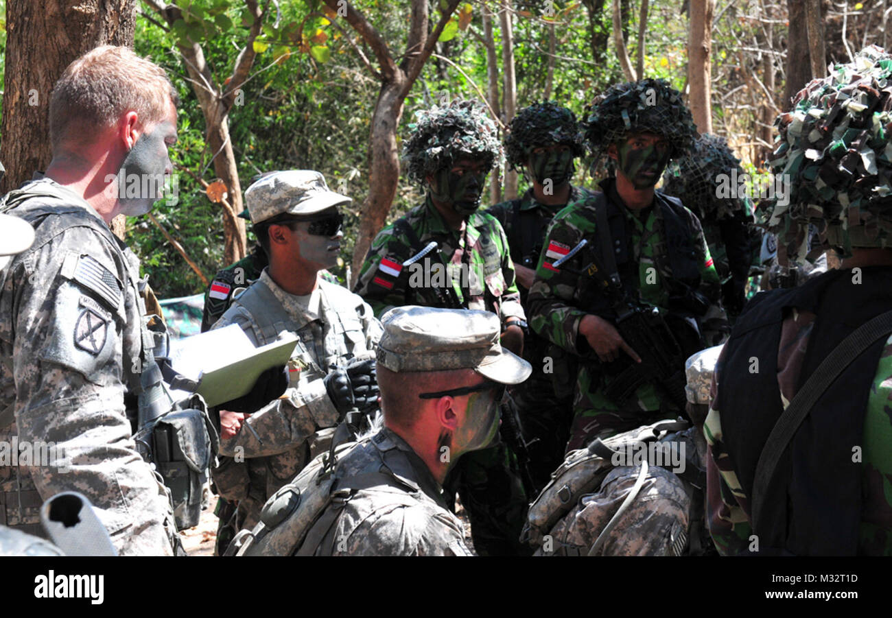 Tentara Nasional Indonesian Armed Forces Tni And U S Army Sol Rs Receive Tactical Briefing By Tni Company Commander Lt Marco Antonio During Operation