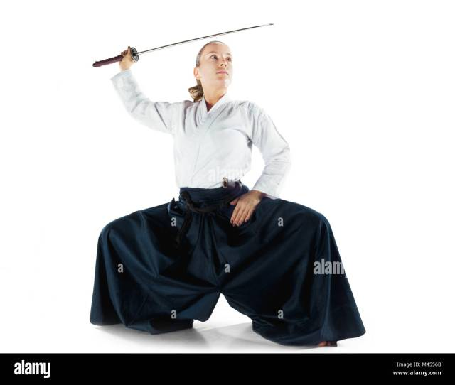 Aikido Master Practices Defense Posture Healthy Lifestyle And Sports Concept Woman In White Kimono On White Background