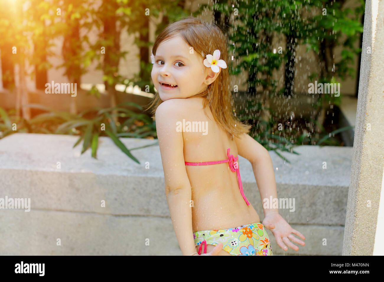 Kid Taking Shower Drops Of Water Fall On Little Girl In