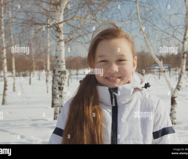 Portrait Of Plump Teen Girl Between The Trees In Winter Stock Image