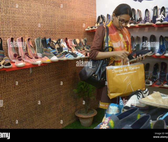 A Visitor Looks At Jute Shoes At A Stall Of Jute Fair In Dhaka Bangladesh On March 6 2018 The Three Day Fair Kicked Off On Tuesday