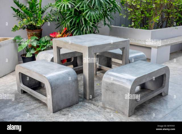 concrete outdoor furniture set in the small garden including on