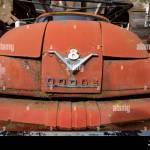 The Chromed V 8 Dodge Logo On The Front Of A Red 1955 Job Rated Dodge C Series V 8 Truck In An Old Stone Quarry East Of Clark Fork Idaho Stock Photo Alamy