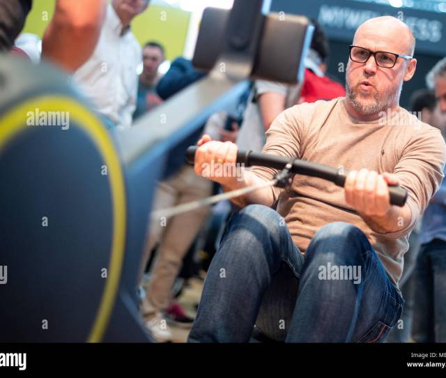 Germany Cologne A Visitor Tests A Rowing Machine At The Technogym Stall Fibo The Worlds Largest Fitness Trade Show Features Products