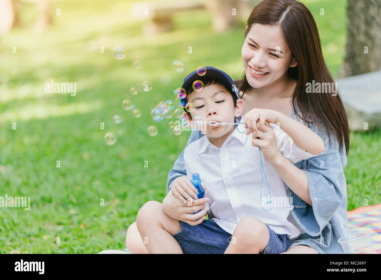 Beautiful Asian Young Mother With Her Son Happiness Moments Playing Together While Picnic In The Park On Holiday For Single Mom Concept