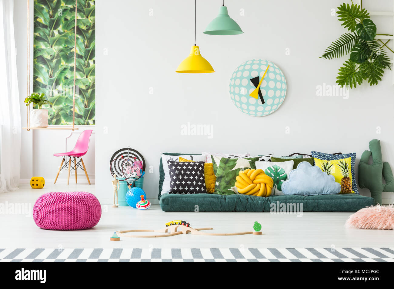 https www alamy com pink pouf and kids toys on the floor in bright playroom interior with many pillows on the couch image179607020 html