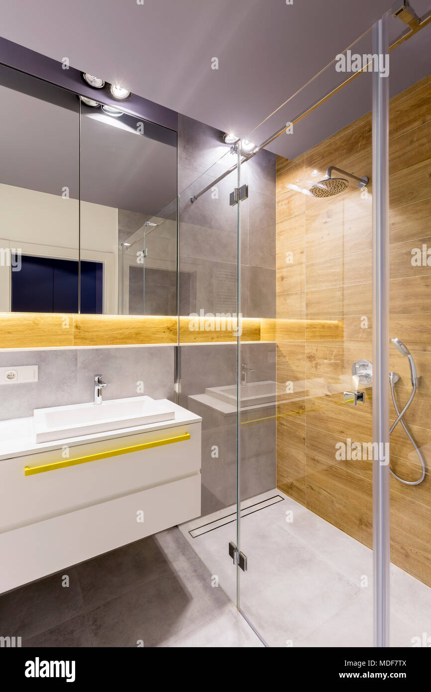 https www alamy com modern bathroom interior with glass shower cabin dark gray tiles mirror and white washbasin image180429674 html