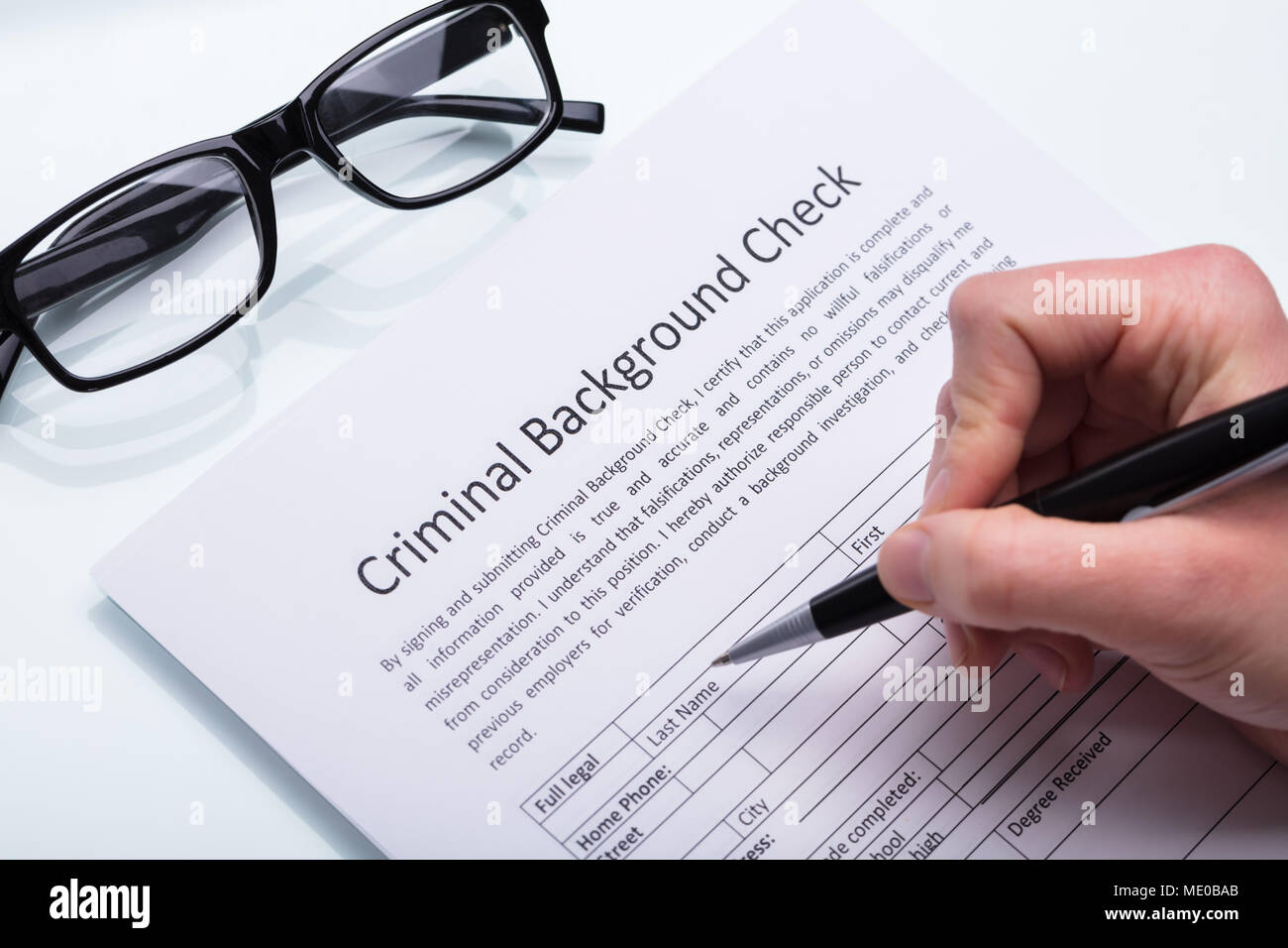 Close up Of A Person s Hand Filling Criminal Background Check Form     Close up Of A Person s Hand Filling Criminal Background Check Form With Pen