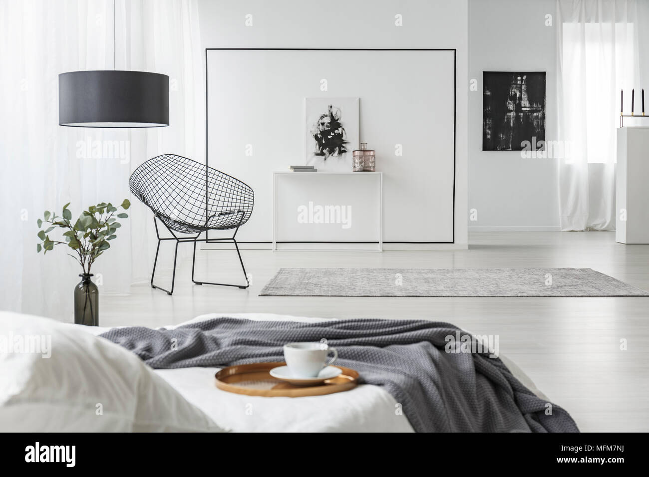 https www alamy com golden tray with a cup on the bed with a grey blanket in white bedroom interior with metal armchair lamp and decorations image181768654 html