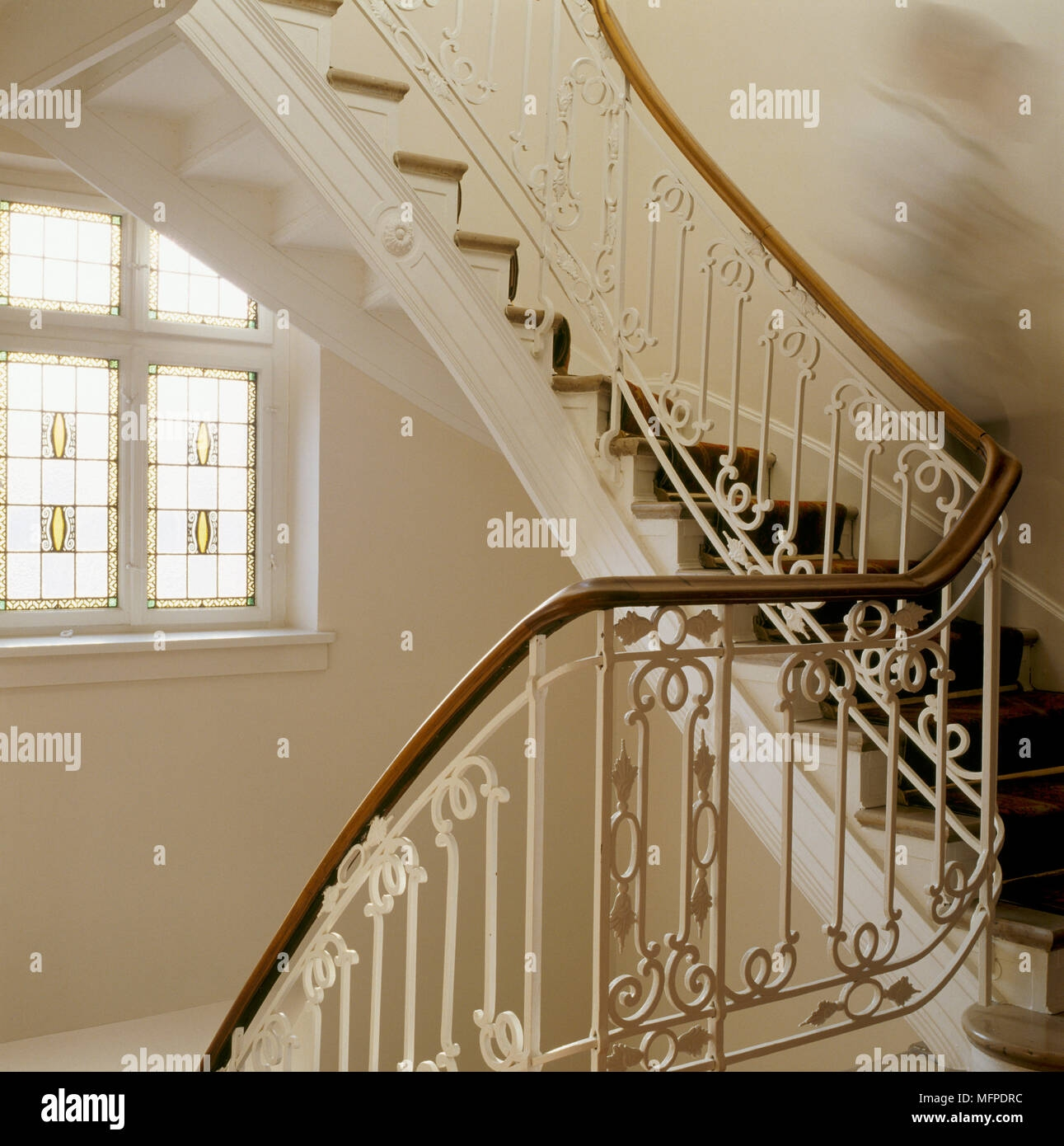 A Detail Of A Traditional Curving Staircase Decorative Wrought   Rod Iron Spindles For Staircase   Interior   Cast Iron   Square   Custom   Metal