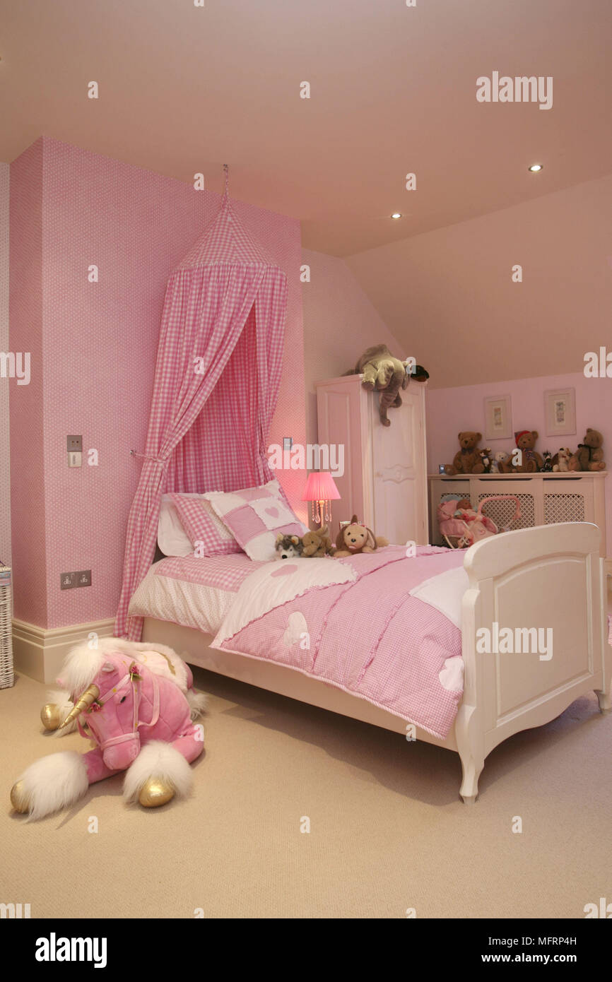 Single Bed With Pink Canopy In Girls Bedroom Stock Photo Alamy