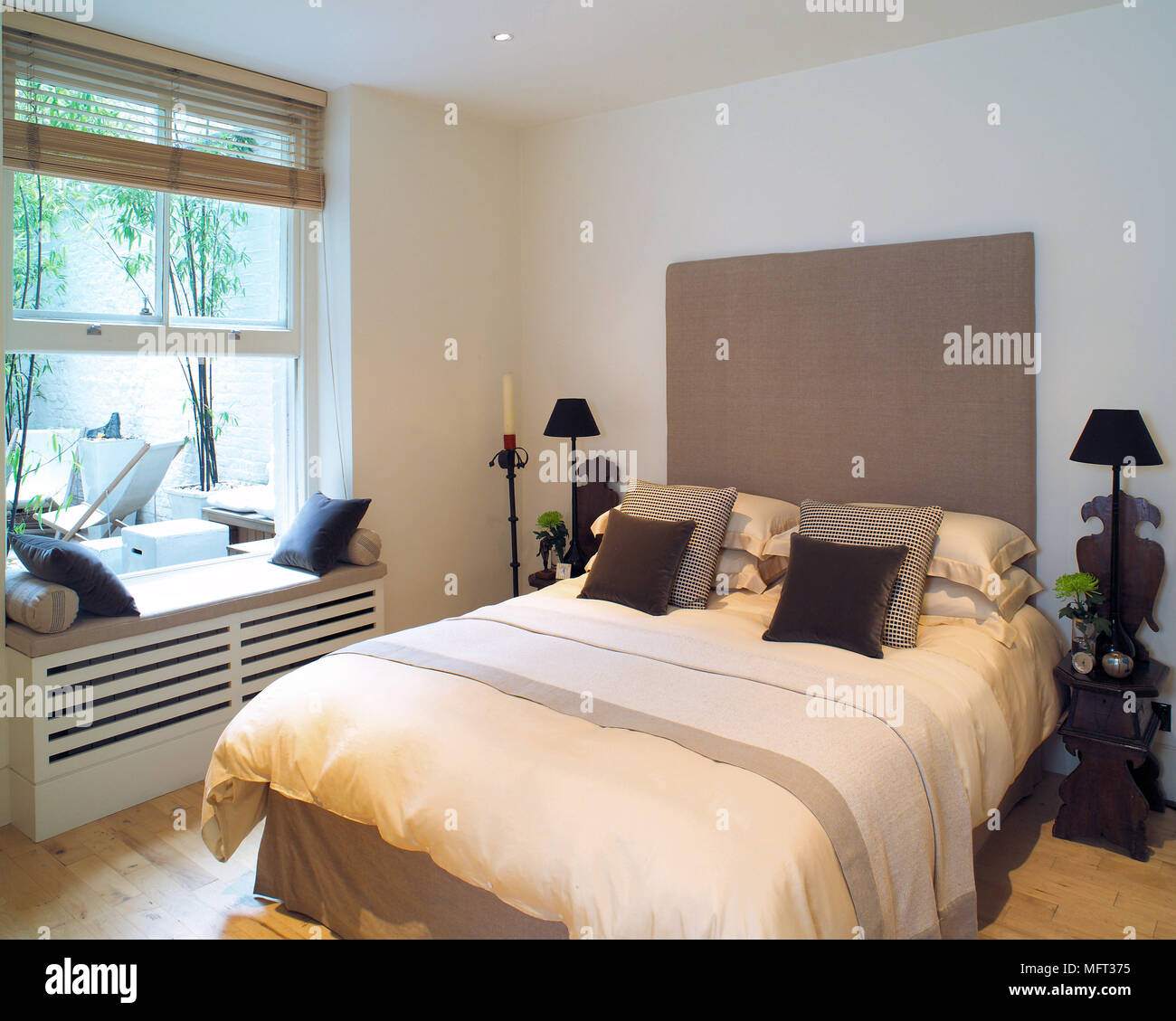https www alamy com modern white bedroom bed upholstered headboard window seat interiors bedrooms beds image181852921 html