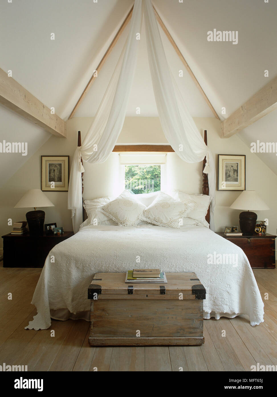 https www alamy com wooden chest at end of double bed in bedroom with vaulted ceiling image181855230 html