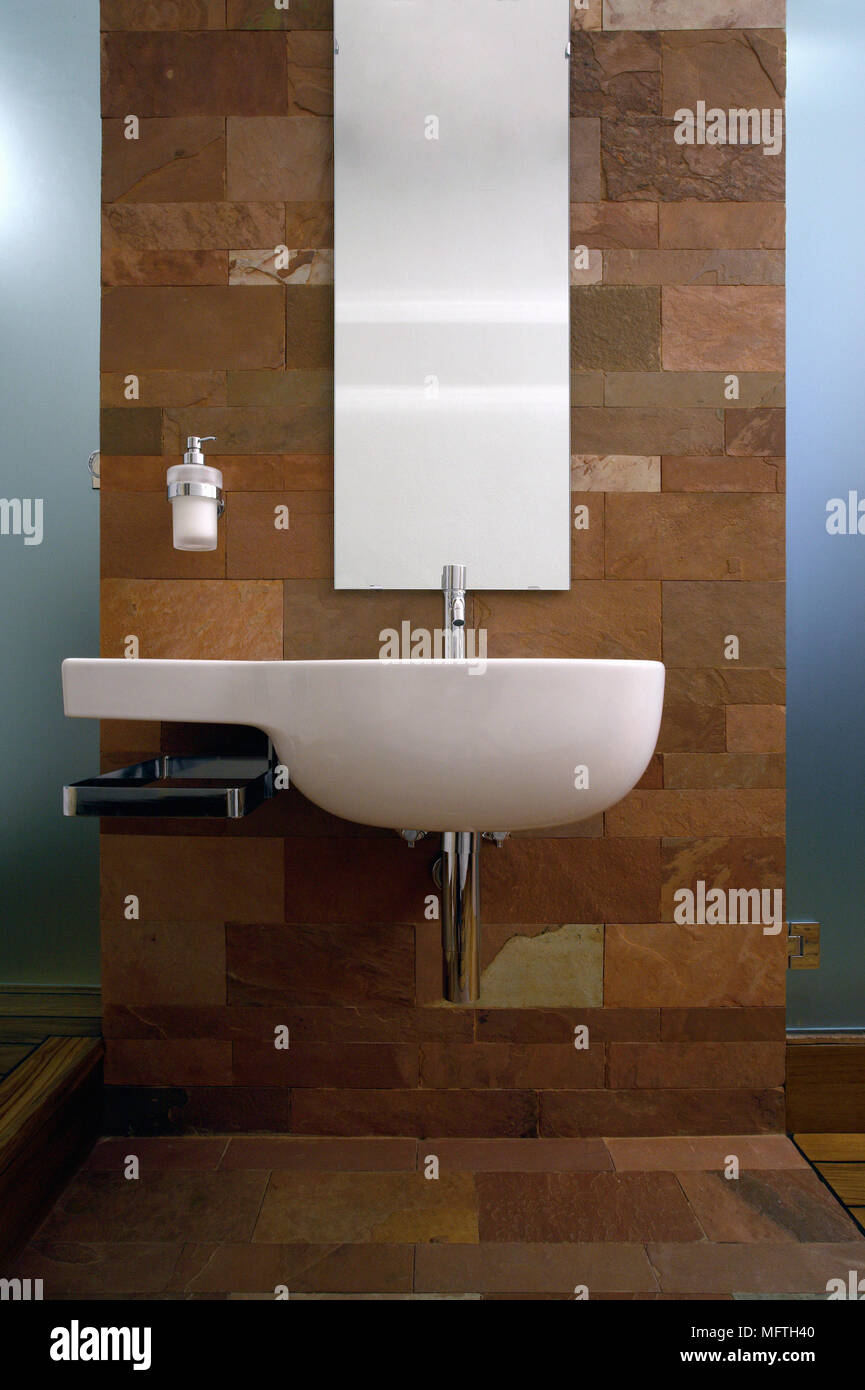 https www alamy com modern wash basin mounted on a stone wall with a soap dispenser and a narrow mirror image181863808 html