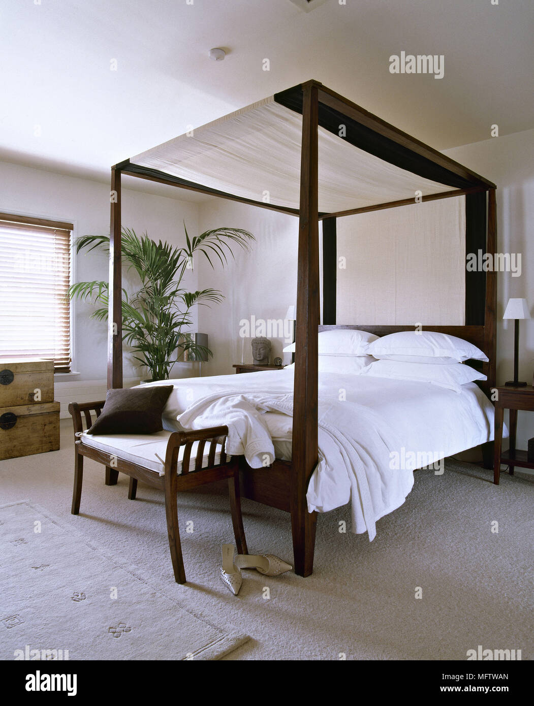 https www alamy com a modern bedroom with four poster bed white bed linen canopies carpet image181870269 html
