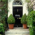 Topiary Shrubs In Pots Either Side Of Georgian Front Door Stock Photo Alamy