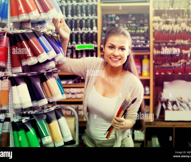 Young Gay Woman Shopping Various Color In Tube In Art Store