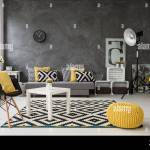 Spacious Grey Living Room With Sofa Chairs Standing Lamp Small Coffee Table Decorations In Yellow Black And White Stock Photo Alamy