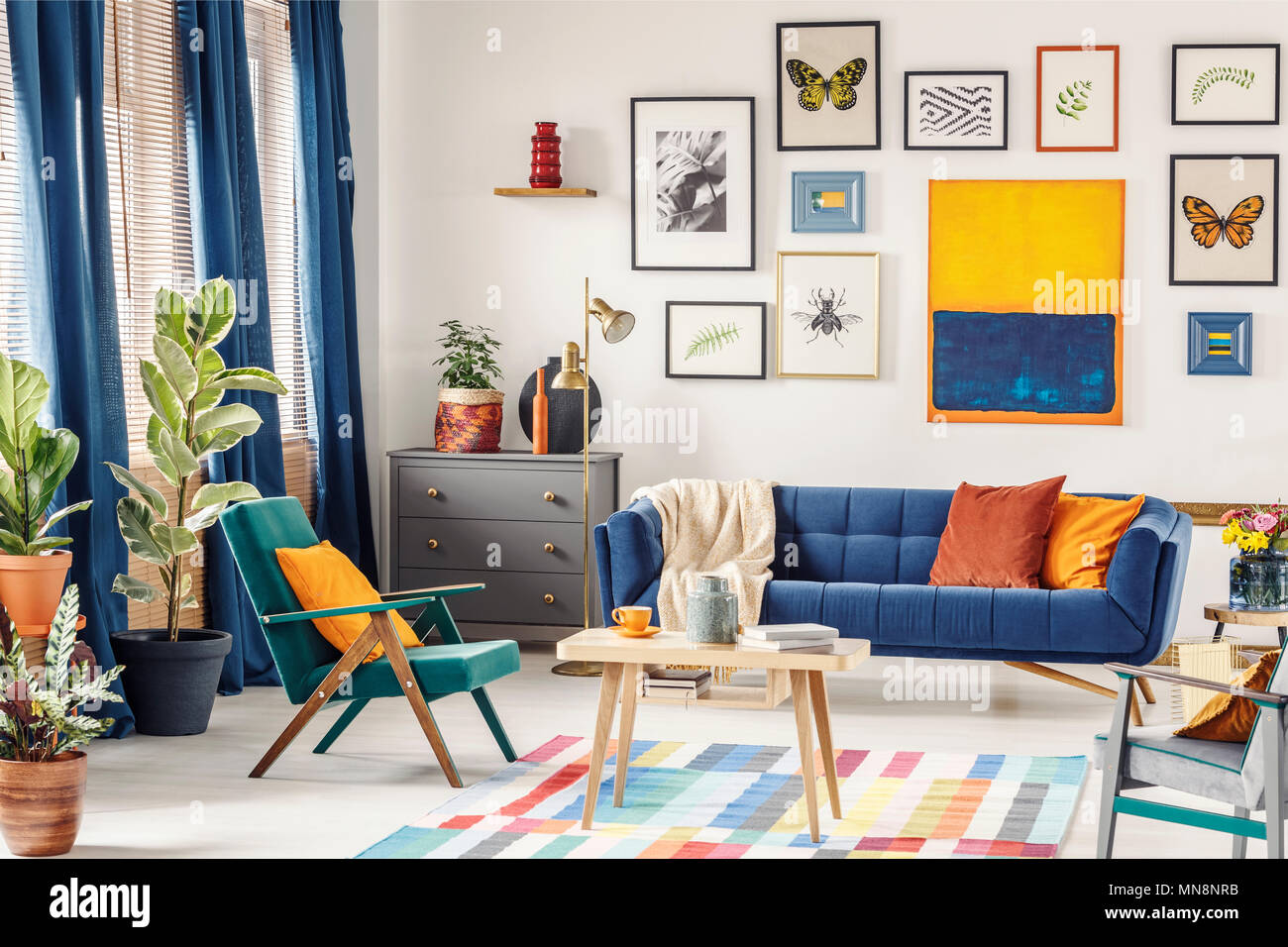 Simple Posters Hanging On The Wall In Bright Living Room