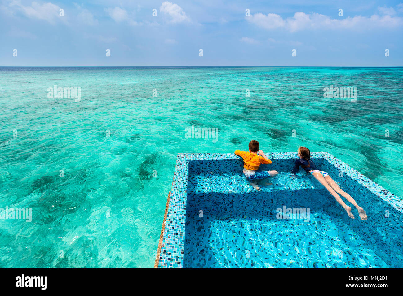 Kids Brother And Sister At Infinity Swimming Pool Having Fun During Summer Vacation Stock Photo Alamy
