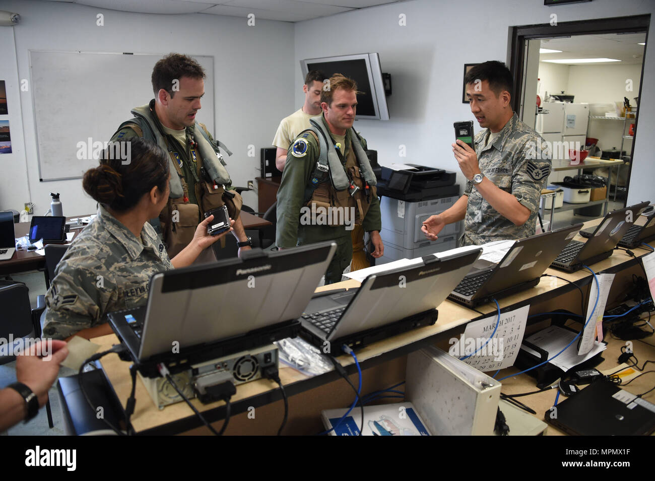Members Of The 144th Maintenance Operations Flight Debrief