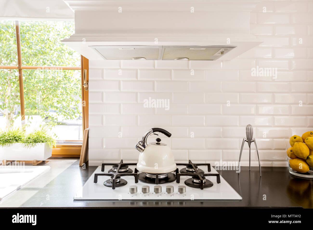 https www alamy com new style kitchen with dark worktop white gas cooker and decorative brick backsplash image187390870 html