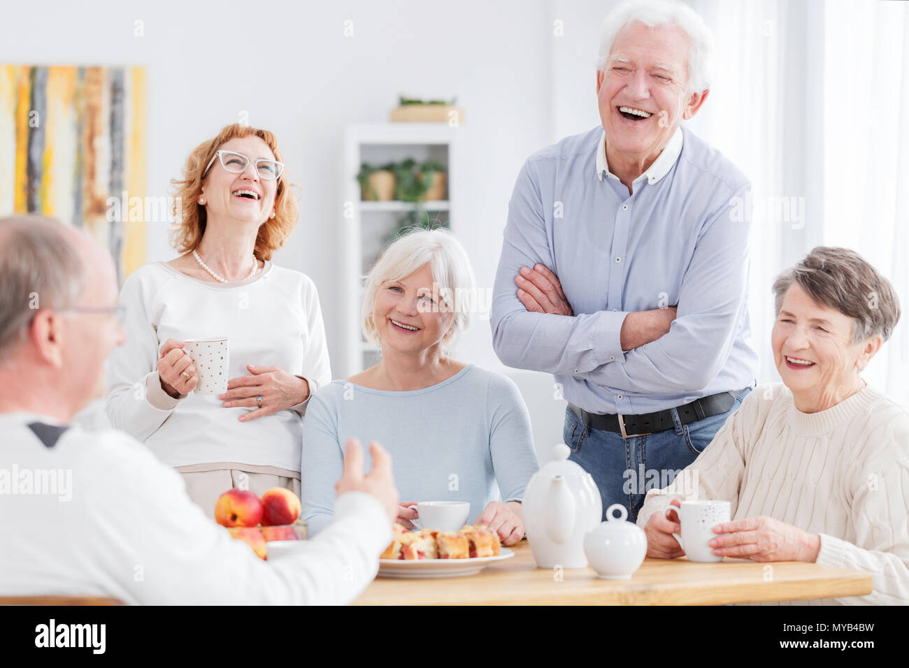 Group Of Happy Older People Laughing Together On A Meeting