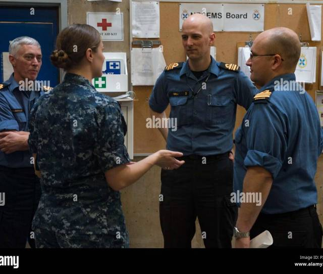 Lt J G Ashleigh Share Converses With Members Of The Royal Canadian Navy During A Conference At The Hmcs Scotian In Preparation For