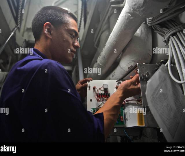 160614 N Qc631 102 South China Sea June 14 2016 Electricians Mate 3rd Class Dominic Santos Conducts Maintenance On An Electrical Box Aboard The