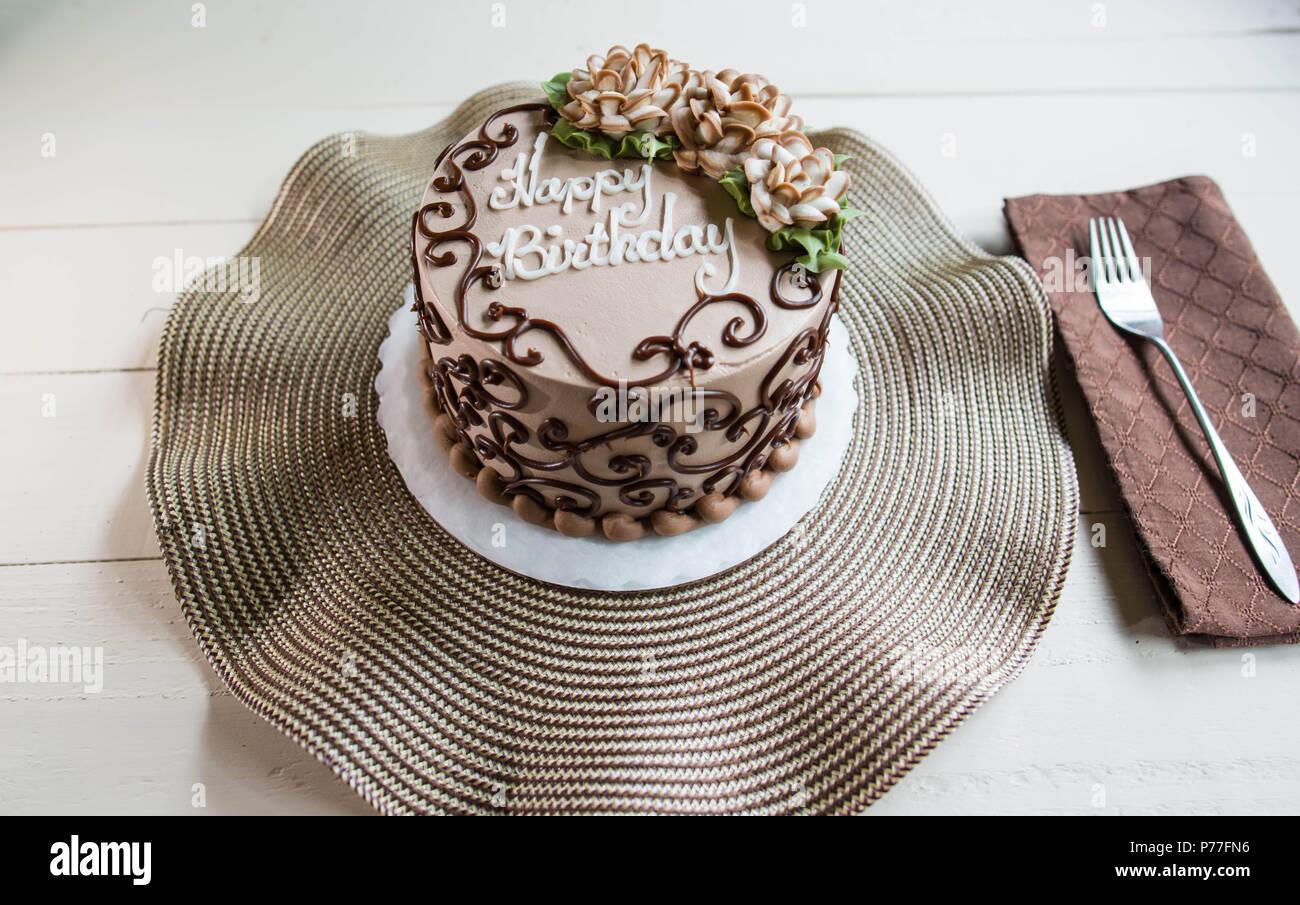 Chocolate Happy Birthday Cake With Flowers Stock Photo Alamy