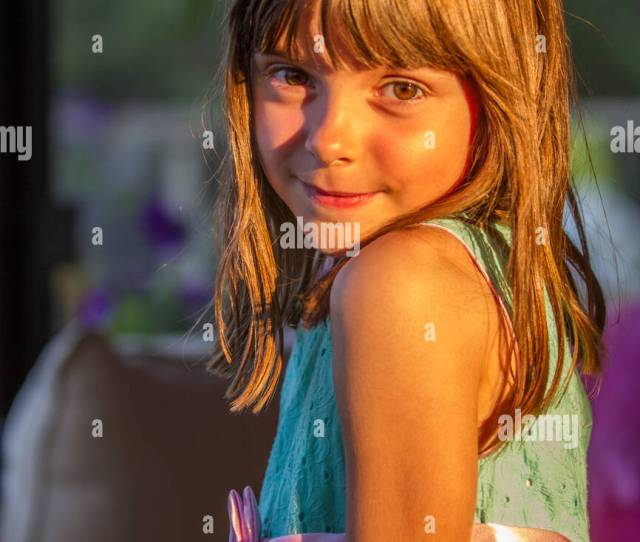 Dark Haired Pretty Pre Teen Caucasian Girl Posing For Camera In The
