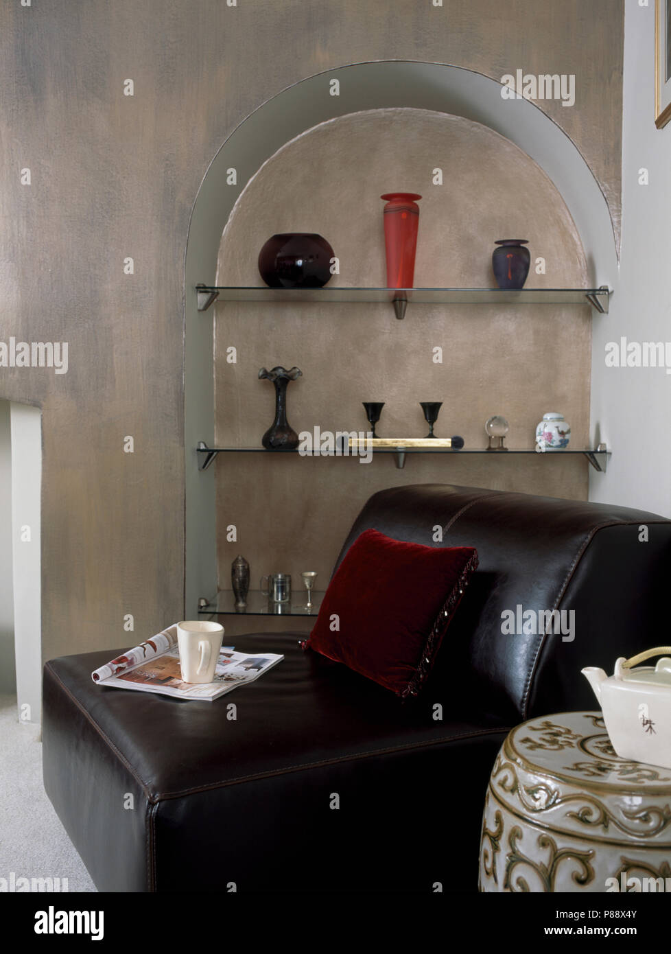 Black Leather Sofa In Front Of Alcove With Shelves In Modern