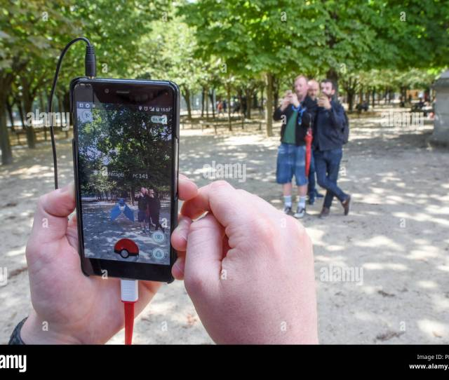 July 14 2016 Paris France Youths Take Part In A Mass Pokemon Hunt In The Luxembourg Garden In Central Paris Hundreds Of Players Of The New Pokemon Go
