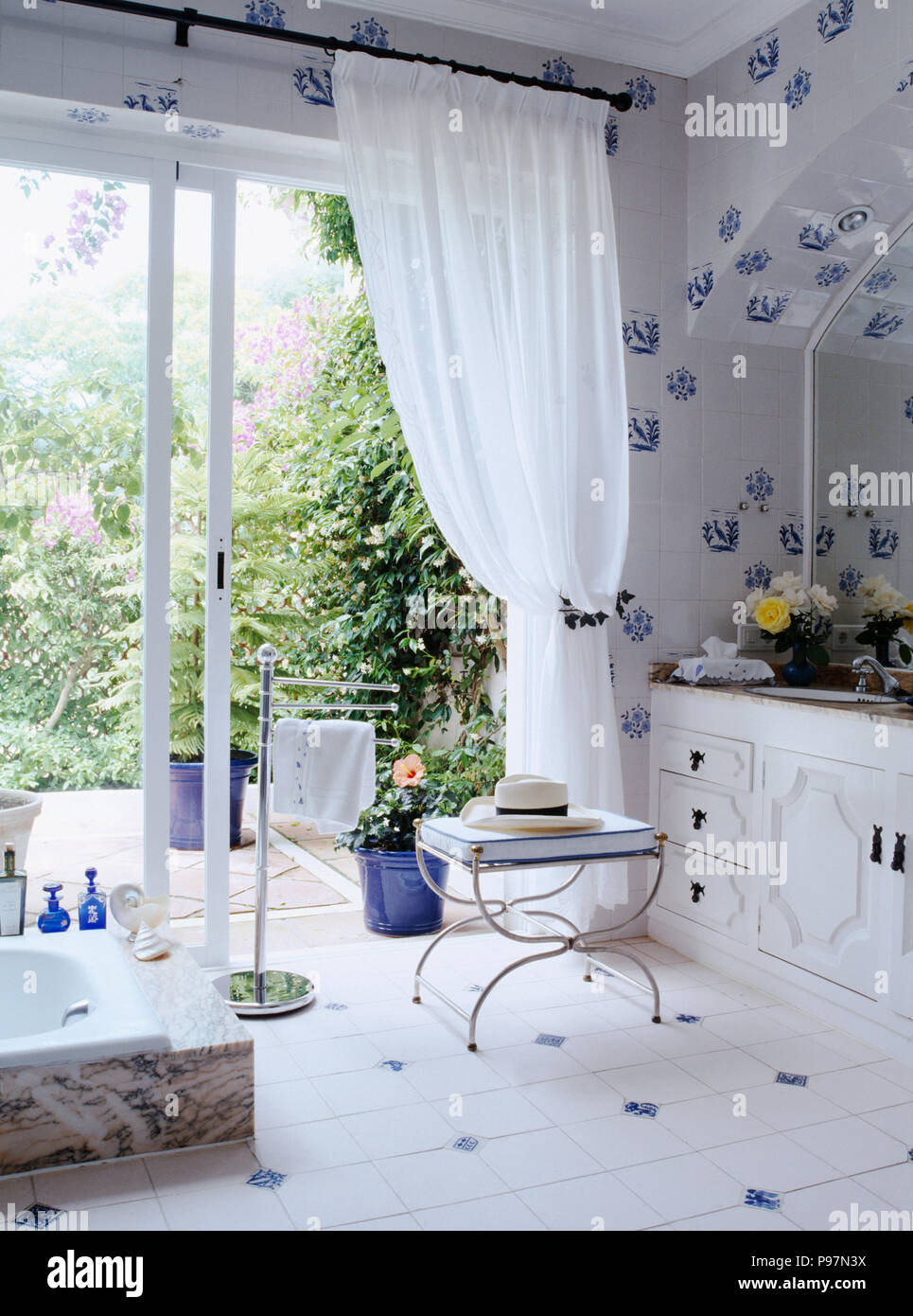 https www alamy com bluewhite ceramic tiled bathroom with white voile curtains on glass doors to patio image212226558 html