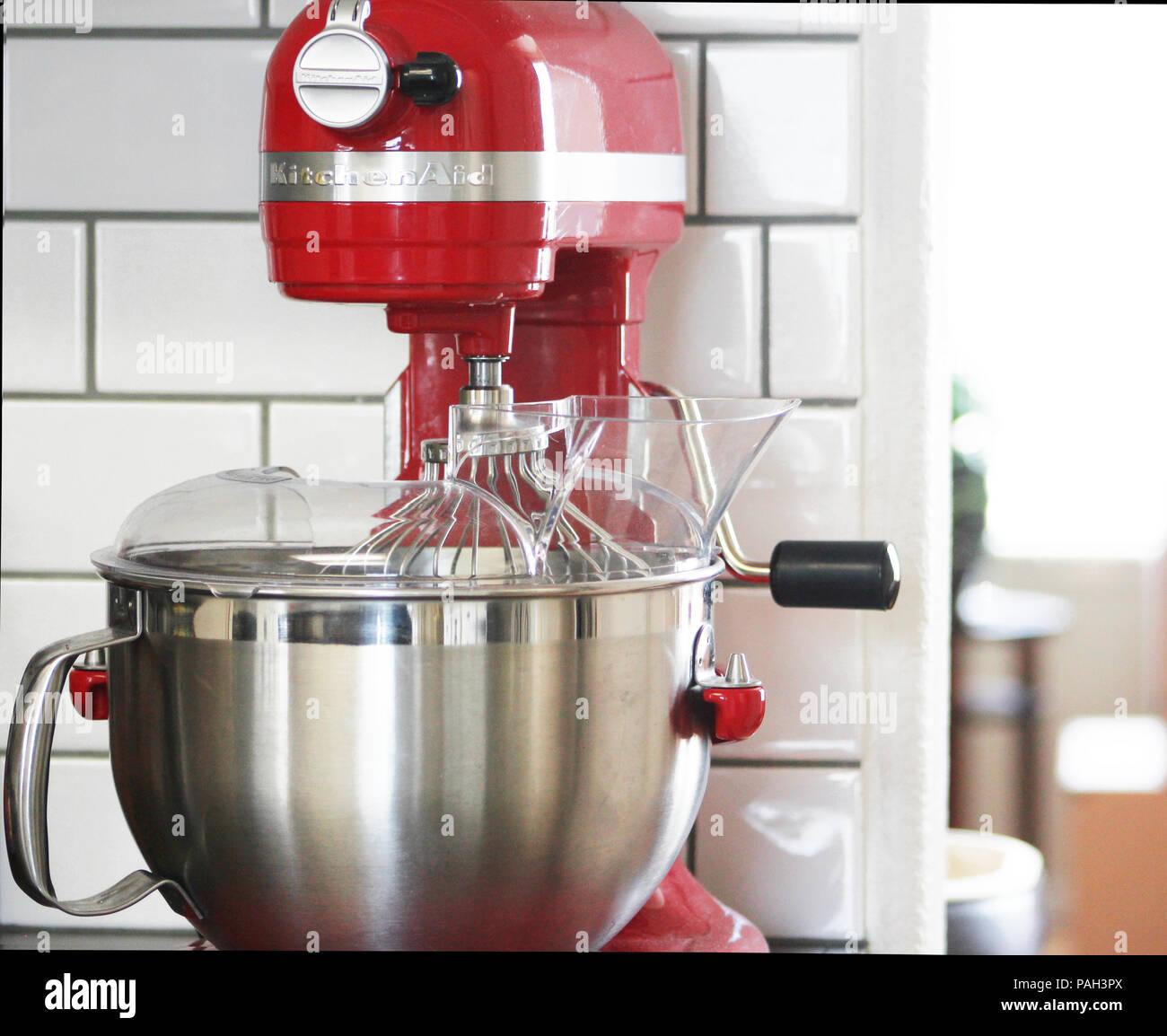 https www alamy com a red kitchenaid mixer against a white subway tile backsplash image213047154 html