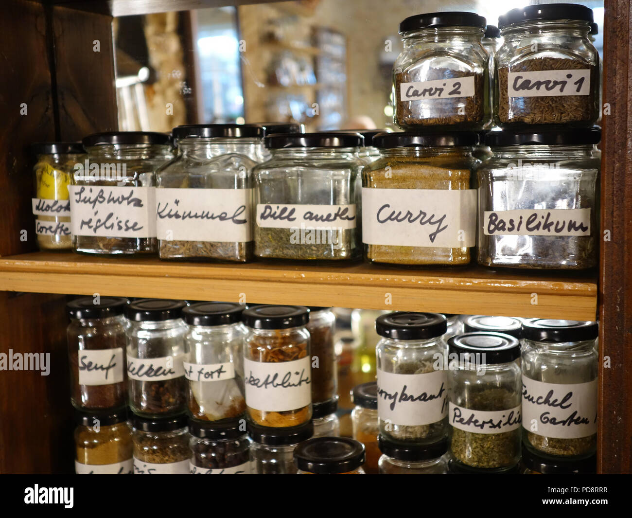 https www alamy com neatly labeled spice jars and herbs on a shelf in a french farmhouse kitchen image214709259 html