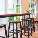 Wooden Chairs And Wooden Counter Bar Table Near The Glass Window In Cafe Stock Photo Alamy