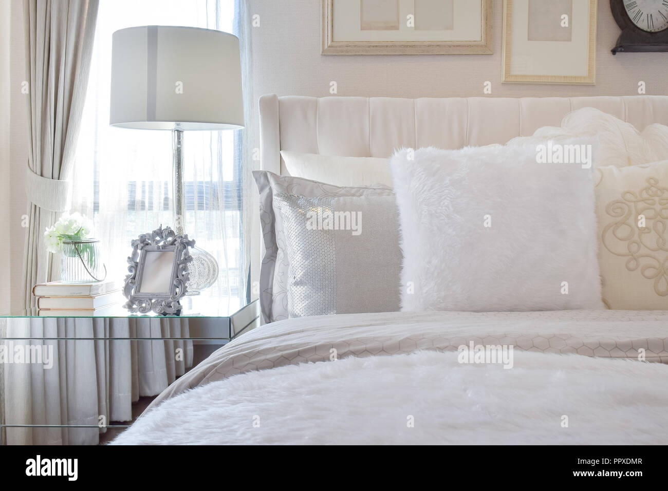 White Lamp With Picture Frame On Glass Bedside Table In