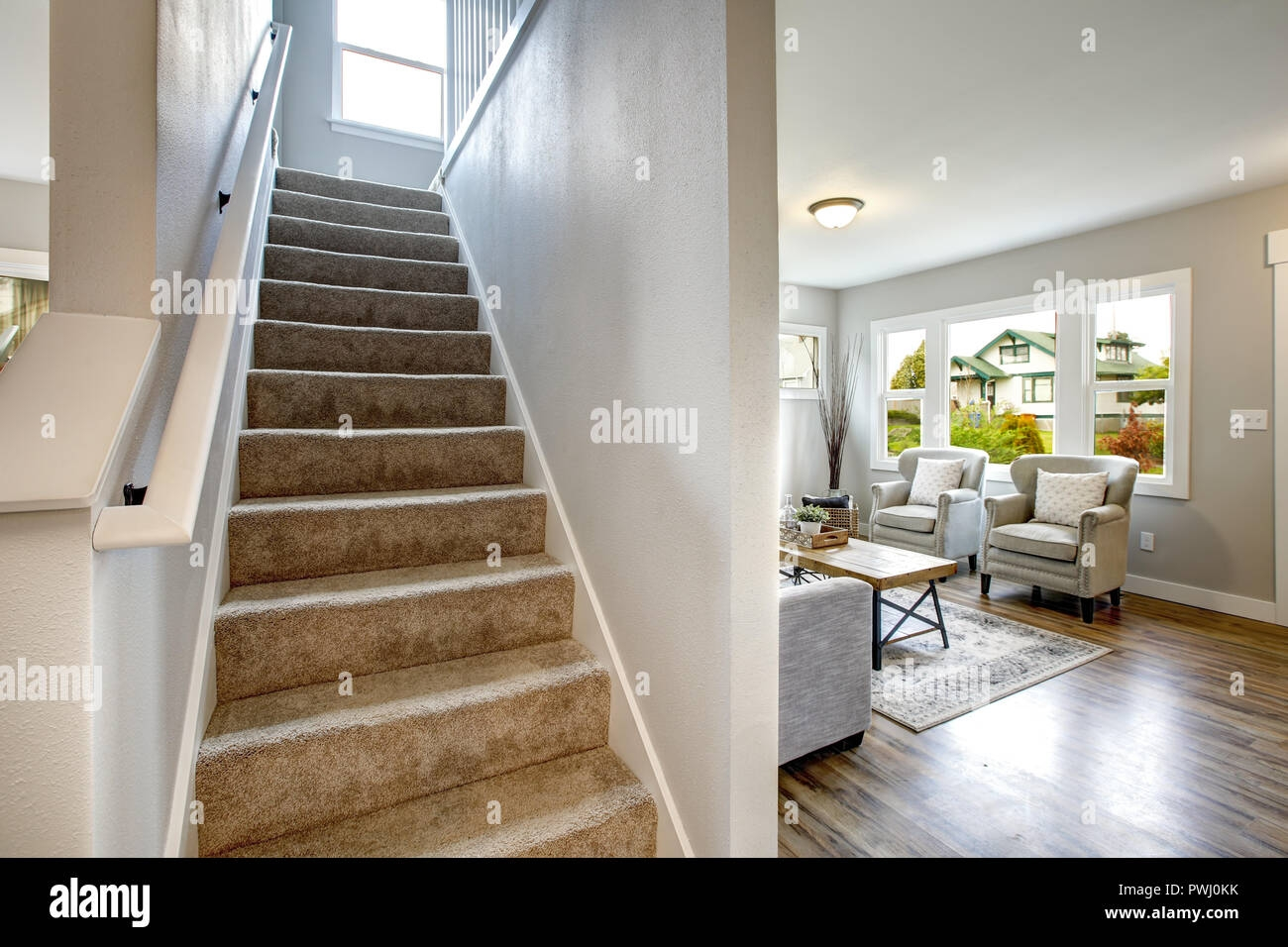 Foyer Staircase Lined With Beige Carpet Runner And Living Room   Beige Carpet On Stairs   Pattern   Dark Beige   Nice   Bound Edge   Hardwood Transition
