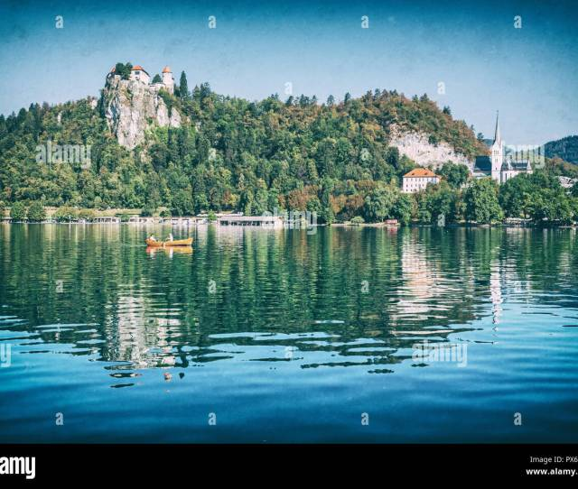 Lake Bled With Castle And St Martins Parish Church Slovenia Europe Travel Destination Summer Vacation Analog Photo Filter With Scratches
