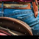 Horse Rider With Knife And Blue Jeans Scenes From A Rodeo And Equestrian Show Warming Up Phase Details Of Saddles Clothing Stirrups And Brown Hor Stock Photo Alamy