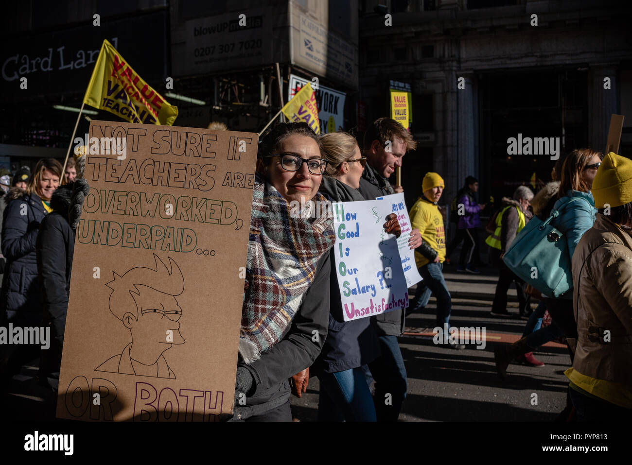A Protester Holds Up A Meme Using The Character From The Tv Show