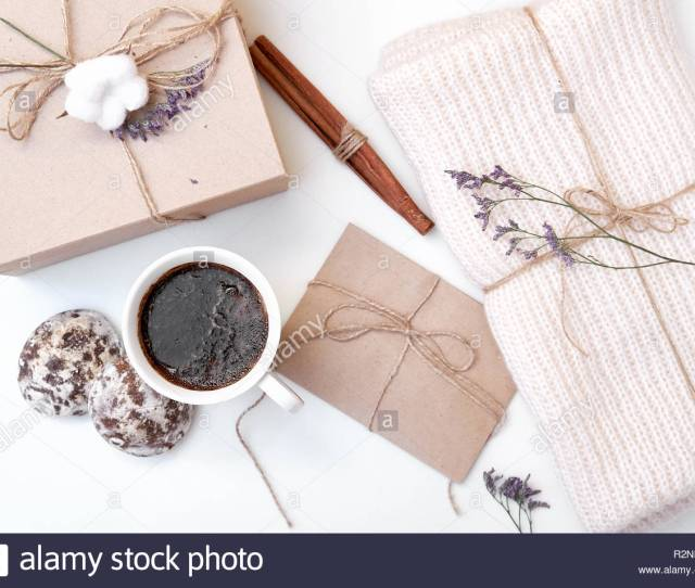 Craft Envelope Gift Box With Bow Knitted Scarf Dried Flowers And Leaves Cup Of Coffee Cinnamon Sticks Gingerbread On White Background Winter H